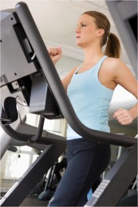 Woman doing HIIT Cardio Treadmill workout